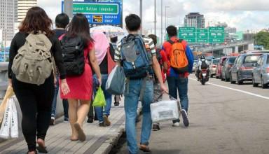 Malaysians walking across the Causeway to Johor Baru