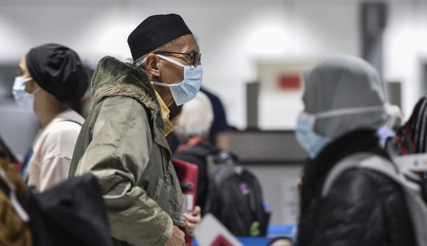 Passengers wearing safety masks in Airport