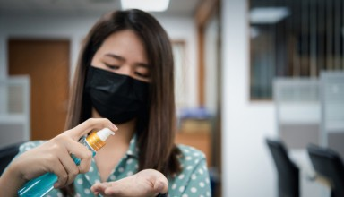 Asian woman wearing mask and alcohol antibacterial hand gel