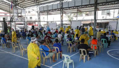 Resident wait Residents wait for their turn during a mass testing for COVID-19 in Manila