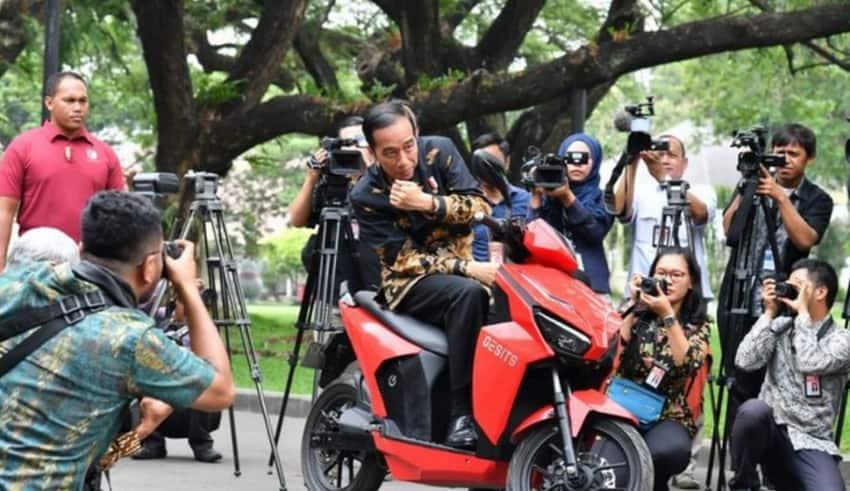 """President Joko """"Jokowi"""" Widodo poses on an electric motorcycle"""