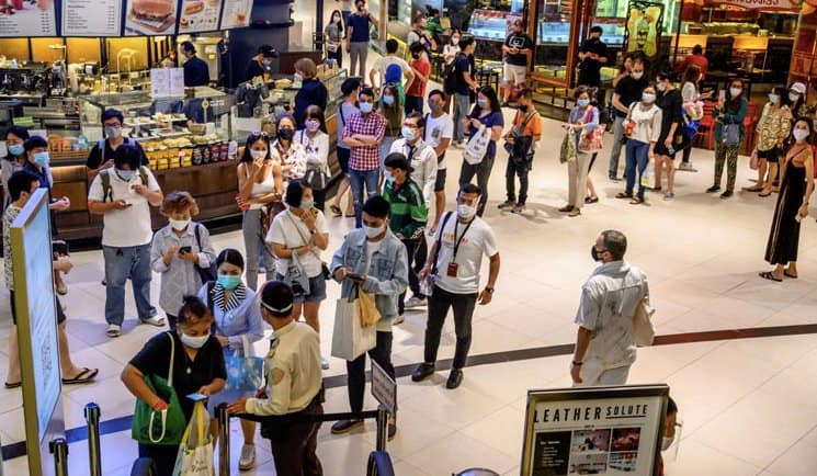 Shoppers lined up to enter Thailand's shopping malls