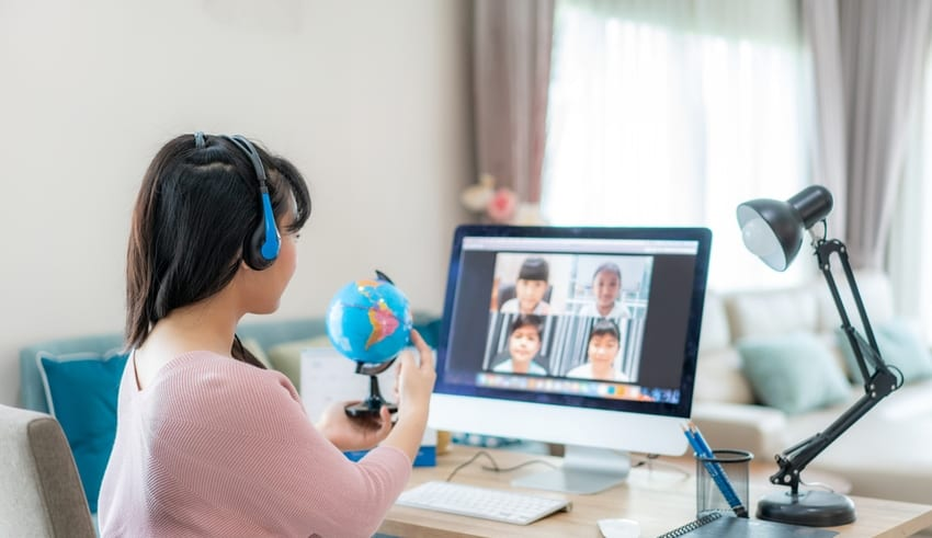 Asian Teacher teaches via video conference for Online class