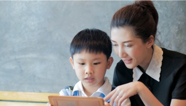 Asian mother son using tablet computer
