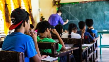 A student follows along as his teacher teaches in Philippines