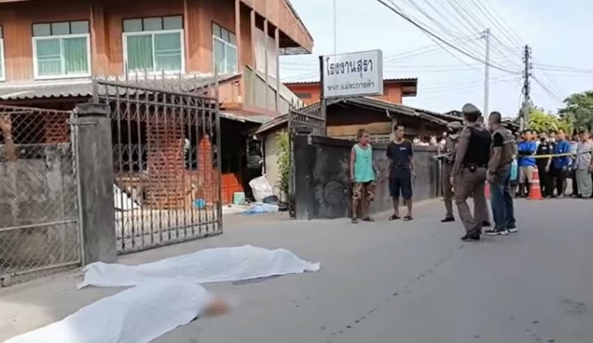 two men lying on the road dead with bullet wounds